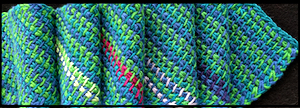 Three-color diagonal Tunisian skinny scarf: its Ravelry project page.