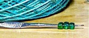 Steel crochet hook ready to hoist some seed beads
