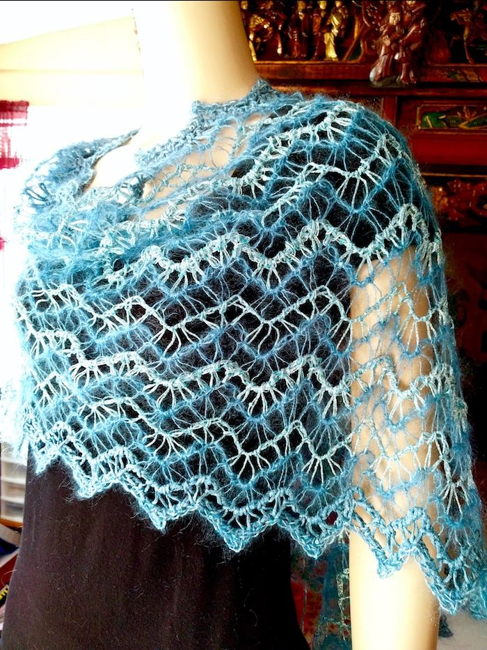 Zegue Wrap is a lacy Tunisian crochet ripple pattern in four imported fashion yarns.