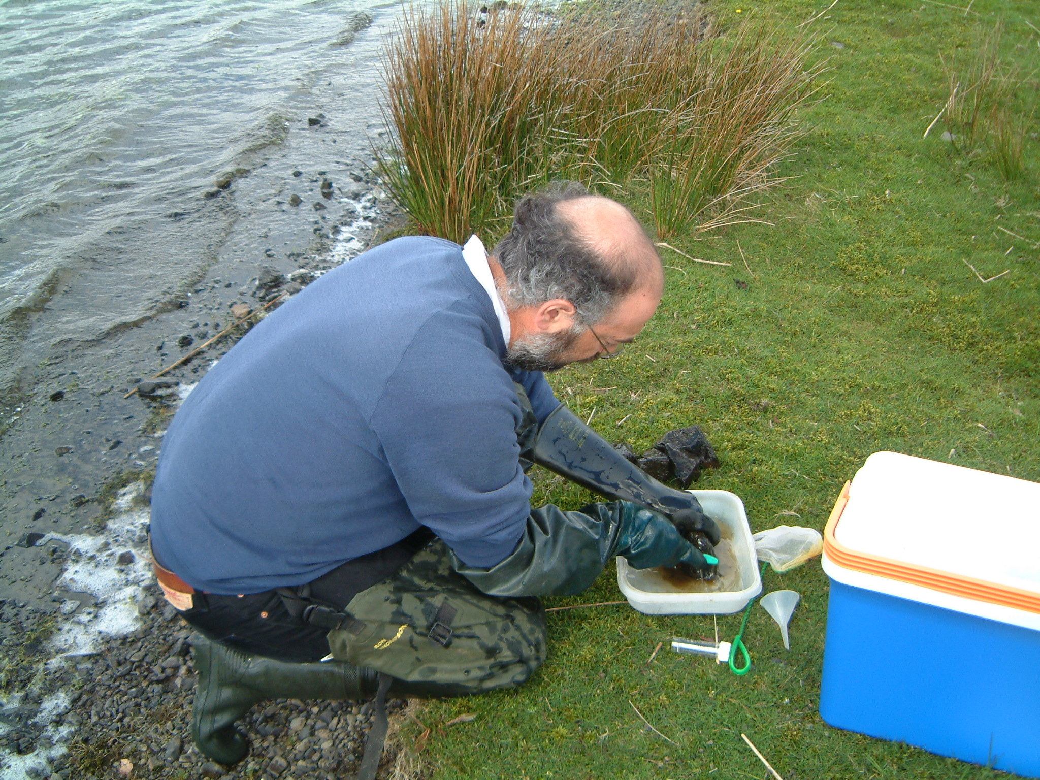 Scientist sampling lake water. Photo © NERC – Centre for Ecology & Hydrology. All rights reserved