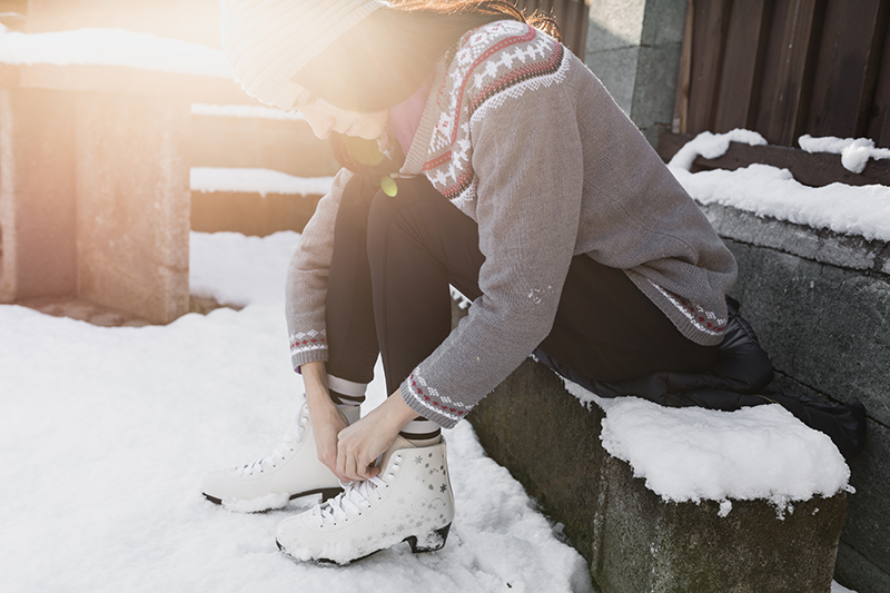 Woman tying ice skates