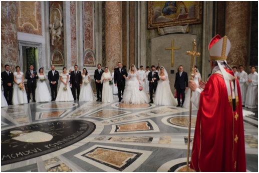 Pope Francis marries 20 couples who have cohabited.