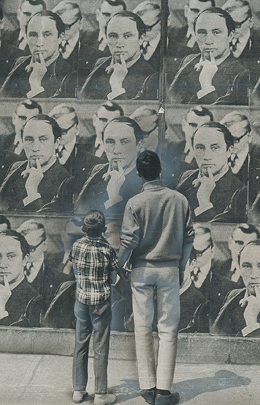 Photo of man and son looking at wall of Pierre Trudeau posters.
