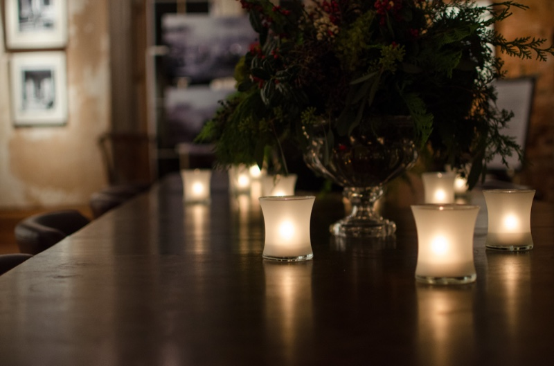 Votive Candles Around Small Christmas Tree Photo by Melanie Jones