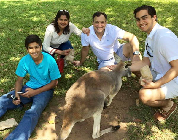 Dean Sheila Pineres with her family, and a kangaroo, in Australia.