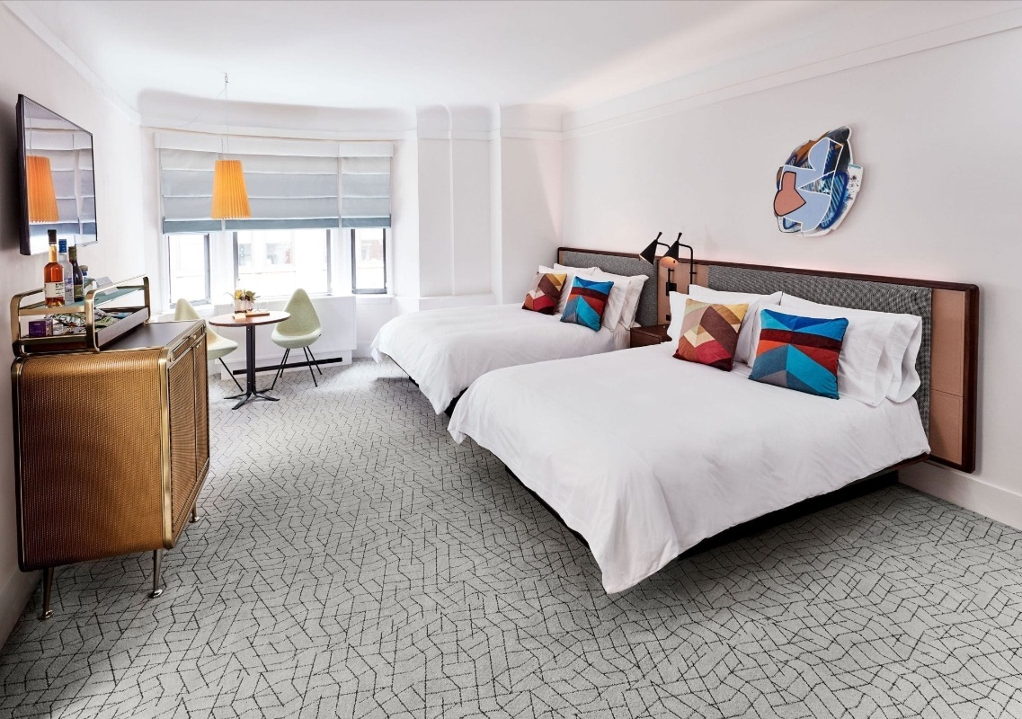 Two queen beds in a deluxe room at the James NoMad