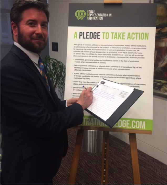 Andrew Mackenzie, chief executive of the Scottish Arbitration Centre, signing the Pledge at its launch in London