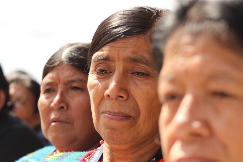 Close up of three Achi women that presented the complaint