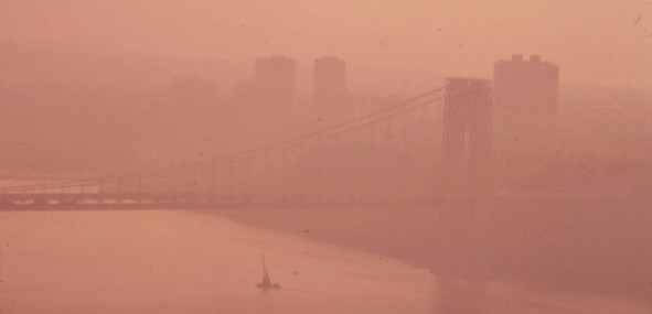 The George Washington Bridge in heavy smog. View toward the New Jersey side of the Hudson River. May, 1973.