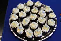 Photo of cupcakes with 311 logo