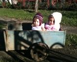 Marie and Sarah in a neighbor's cart!