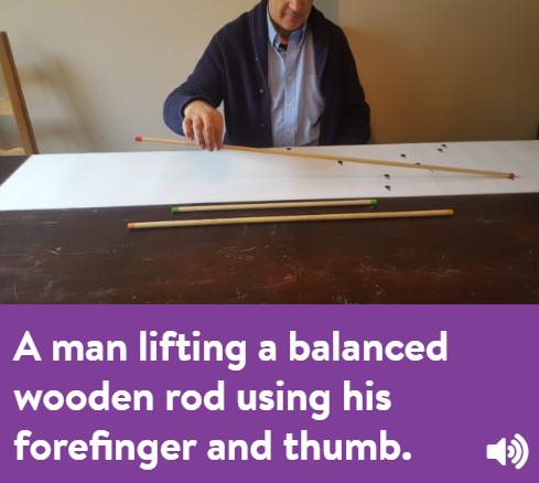 A man lifting a balancing rod