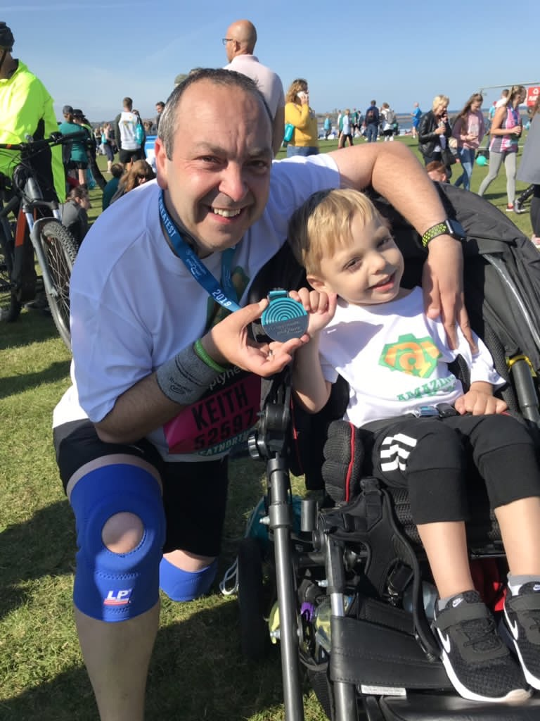 Keith celebrates completing th eGreat North run with his son Aiden
