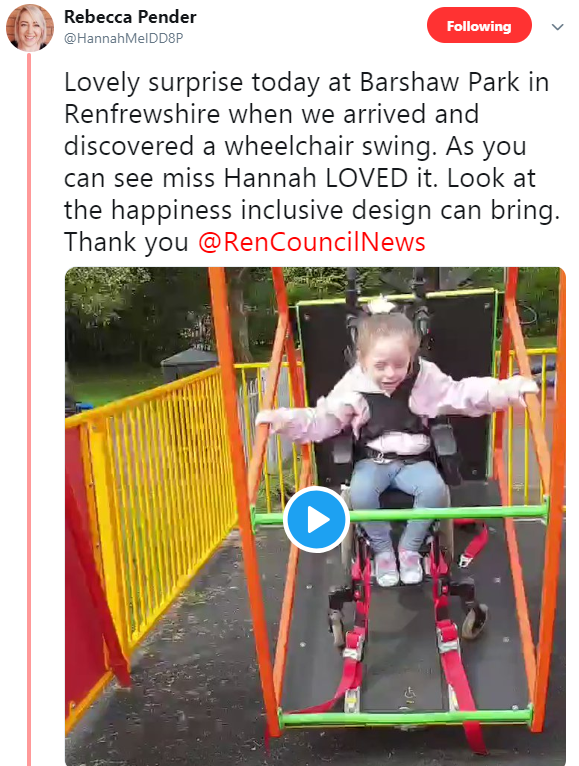 Little girl happy on adapted swing