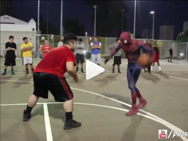 Spiderman playing basketball at the park