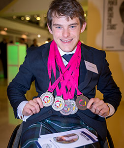 Previous CiaO Award recipient Nathan Blackie showing off his medals