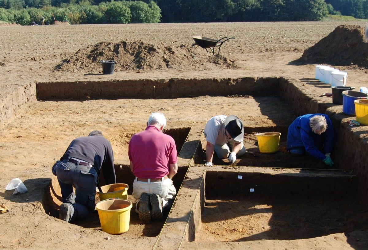 4 people excavating in a trench at Rendlesham