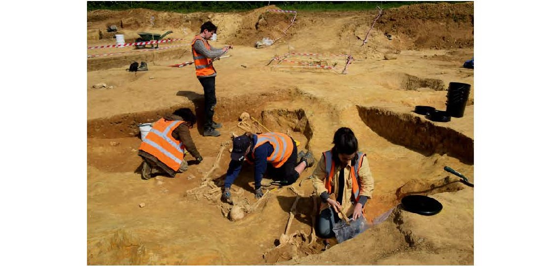 four people excavating Roman graves