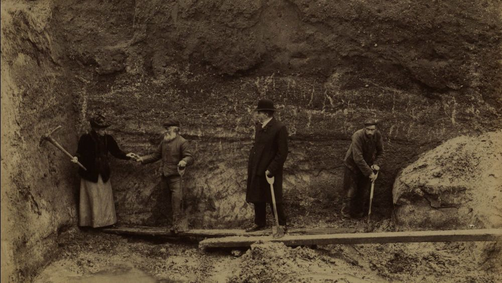 sepia photo of archaeologists excavating in 1900s