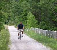 A mountain biker on the North Central State Trail.