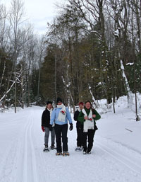 Snowshoers on the Sleeping Bear Heritage Trail.