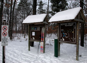The snowy trailhead at Buttles Road Pathway.