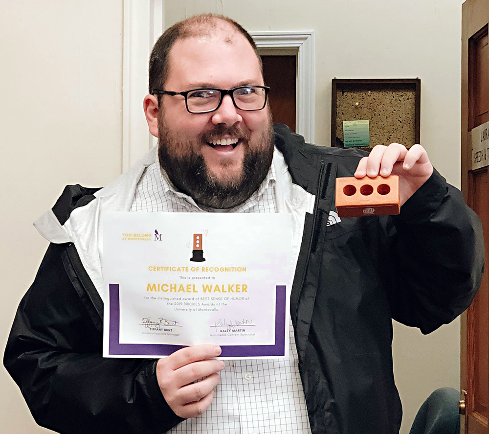Michael Walker holding up his Brickie award