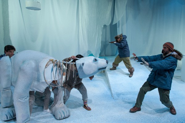 Theatrical image of man and polar bear