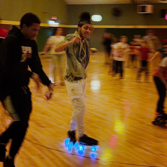 This guy with the lit roller skate wheels had some serious moves.
