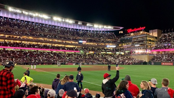 Lights dimmed at Target Field with cell phone lights.