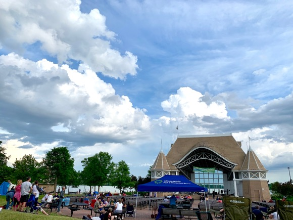 Gorgeous evening, clouds overhead at Lake Harriet bandshell for Music in the Park.