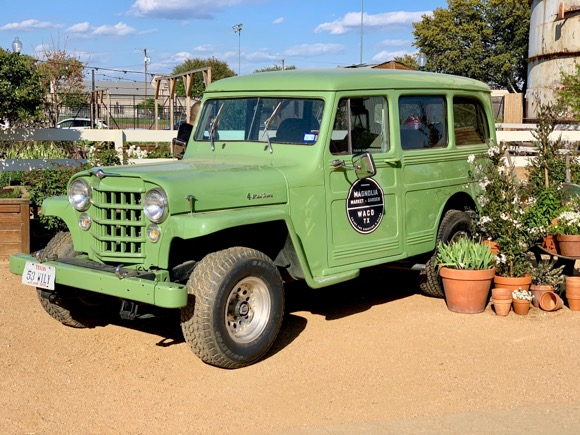 Antique green Jeep at Magnolia Silos.