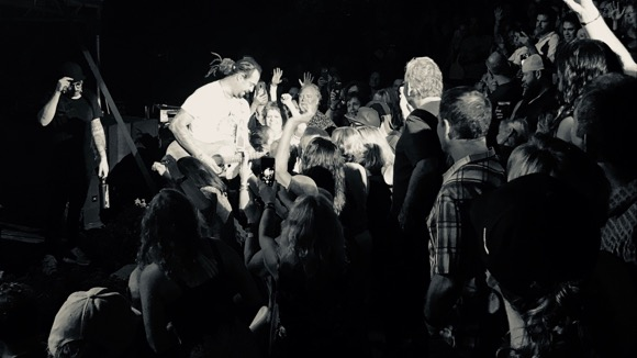 Michael Franti entering the crowd at the Minnesota Zoo.