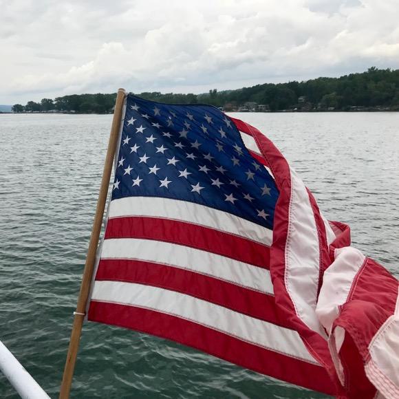 Flag waving behind the Teal on a cruise down Cayuga Lake.