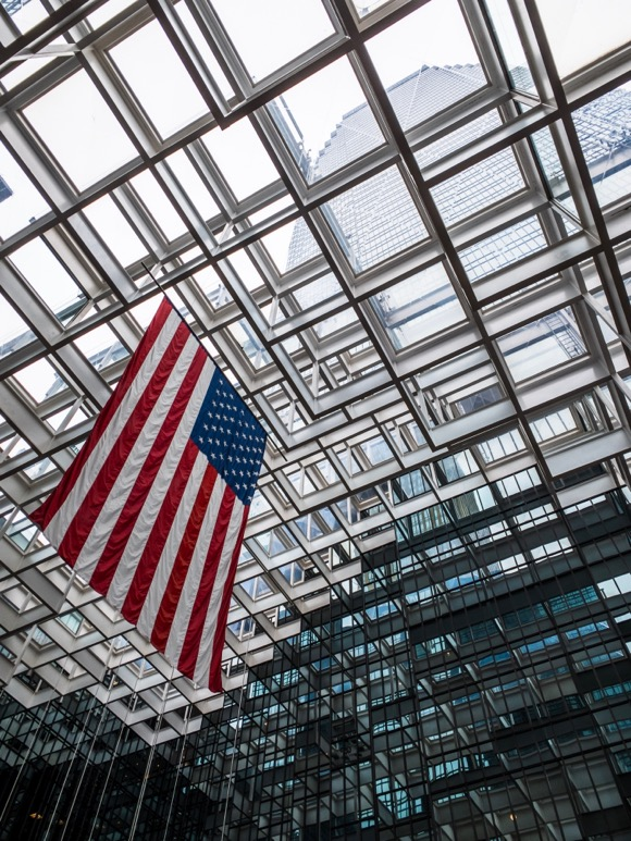 American Flag hanging in the Crystal Court alongside the IDS Center.