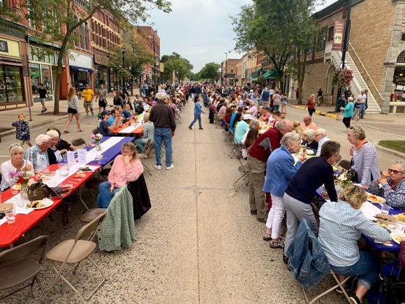 Tables line downtown Northfield for a Community Dinner.