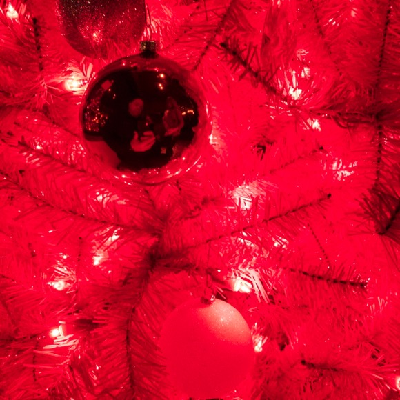 Christmas ball selfie, in this red Christmas tree.