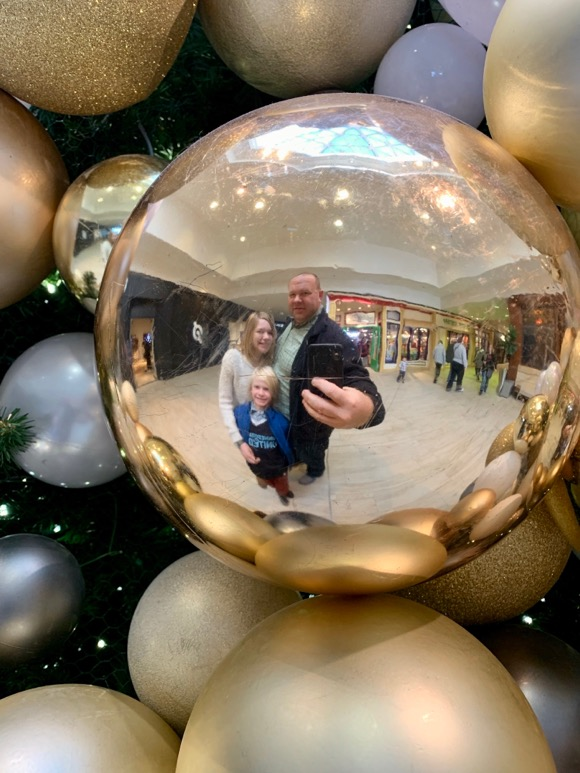 Selfie reflection in a Christmas bauble.