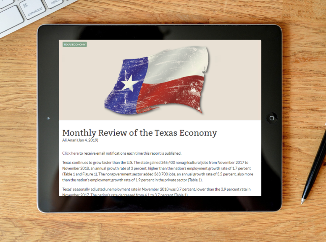 ipad with monthly review of texas economy onscreen