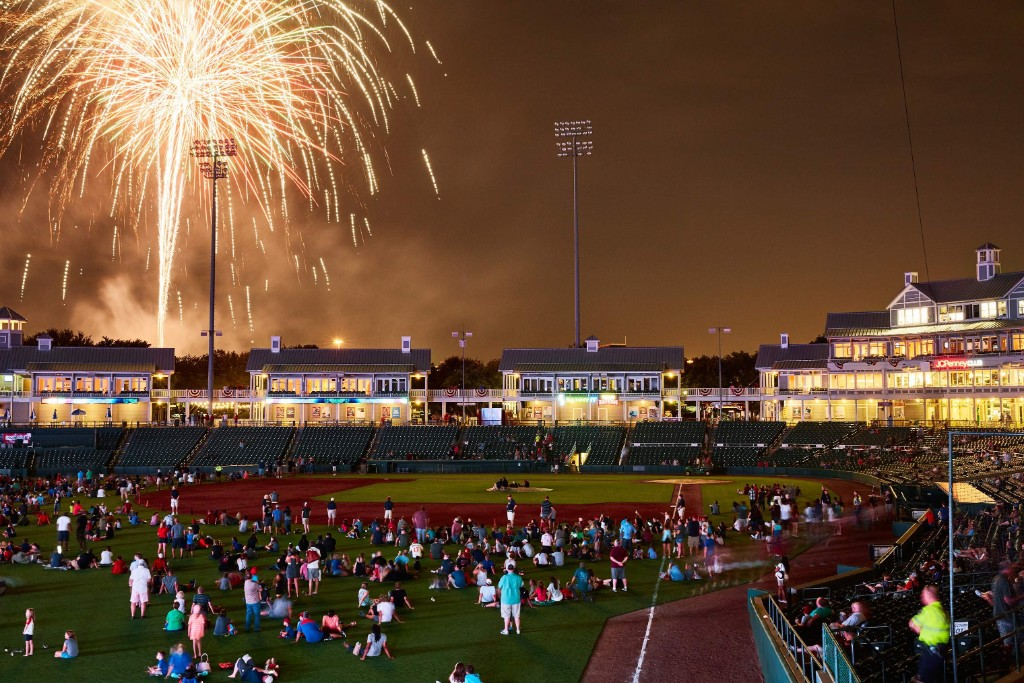 Fans watch a fireworks show after a RoughRiders baseball game at the Dr. Pepper Ballpark in Frisco.