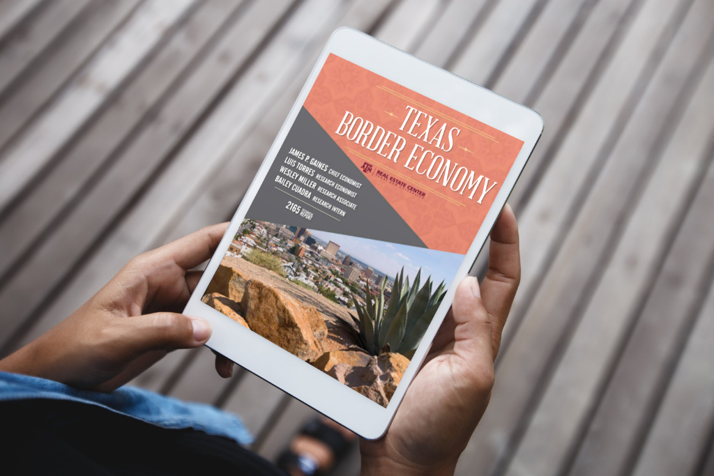 A man hold an iPad with the Texas Border Economy report on the screen.