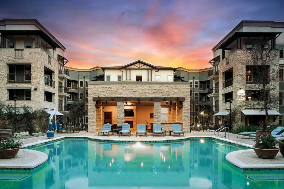 Ridgeline at Rogers Ranch apartment community pool at sunset