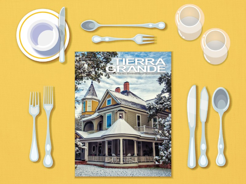 January 2018 issue of Tierra Grande magazine sitting on a yellow dinner table.
