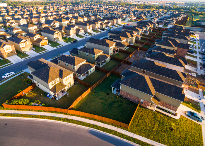 Aerial view at sunset of a housing community in Round Rock, TX