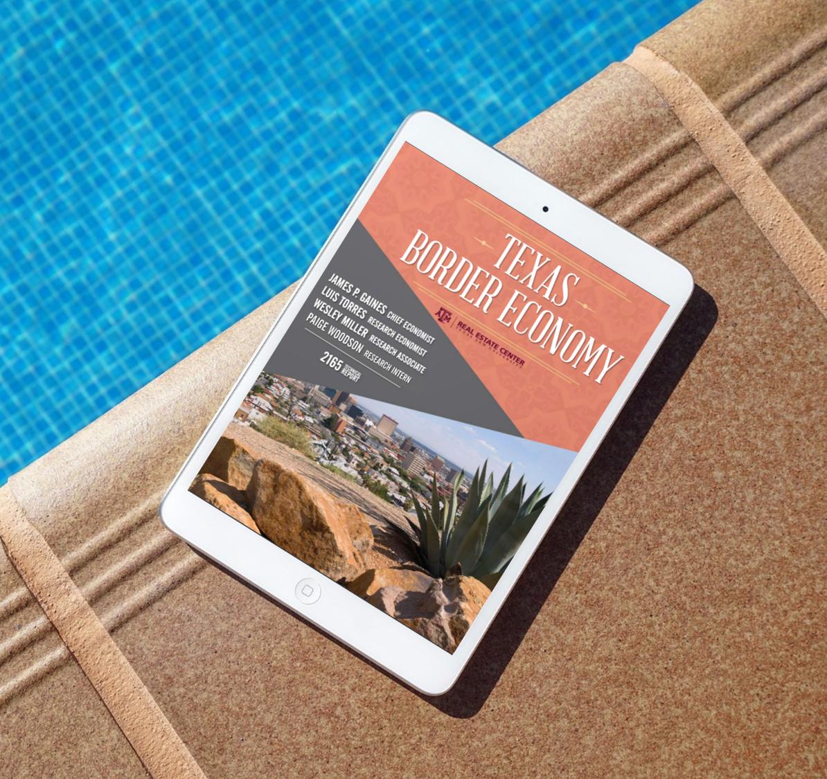 Texas Border Economy on an iPad near a pool