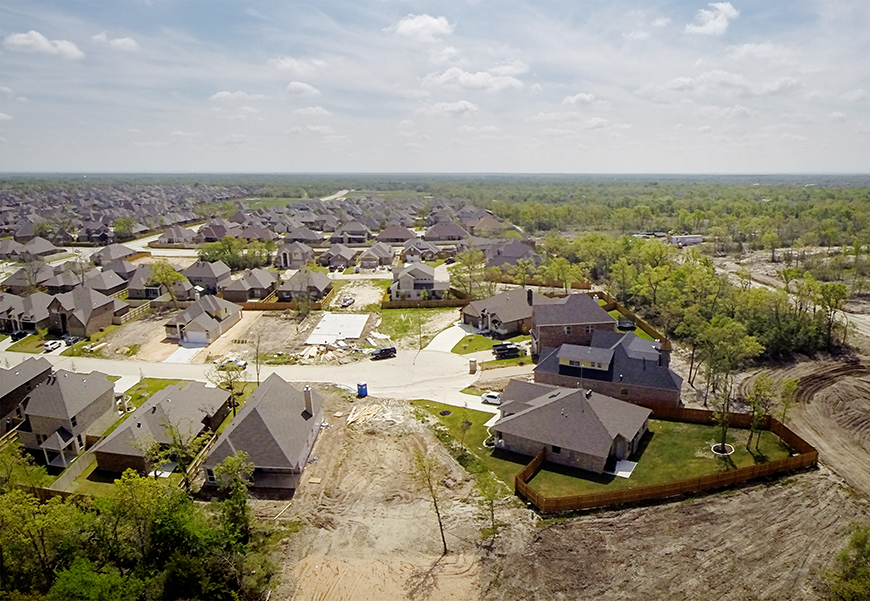 A suburban neighborhood with undeveloped dirt lots