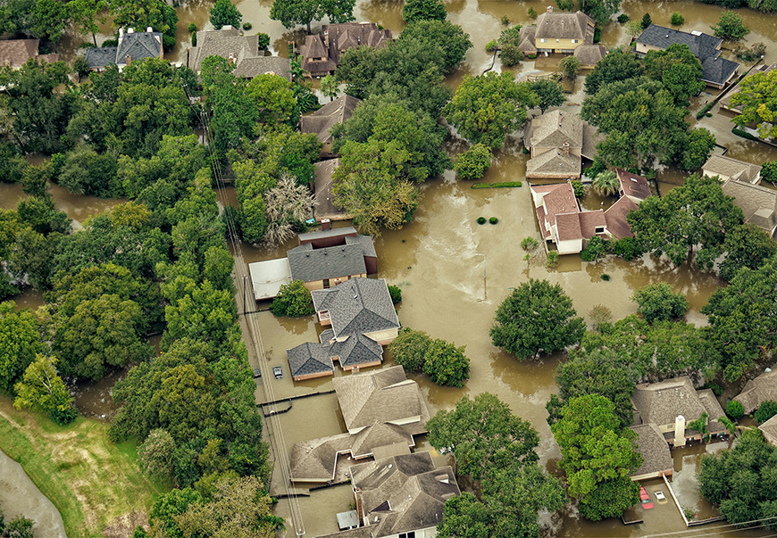 An aerial photograph of a flooded Houston suburb.