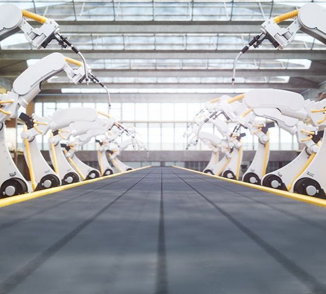 Robot arms on a conveyor belt