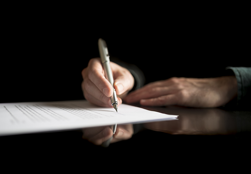 Man signing a will