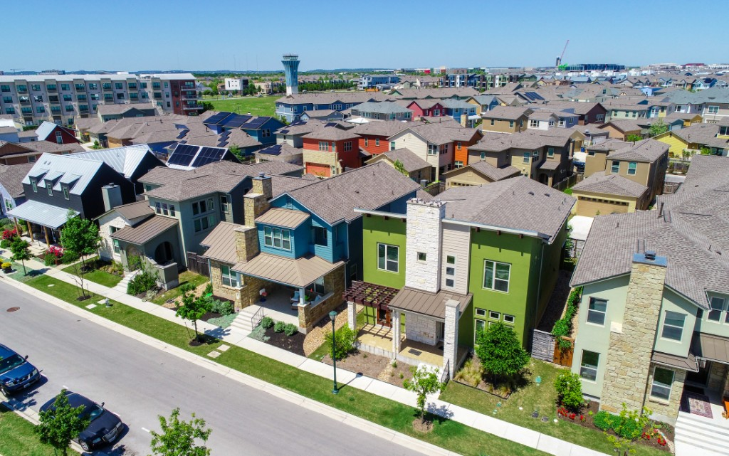 Green and blue and colorful houses facade Aerial drone view of suburb neighborhood in East Austin community